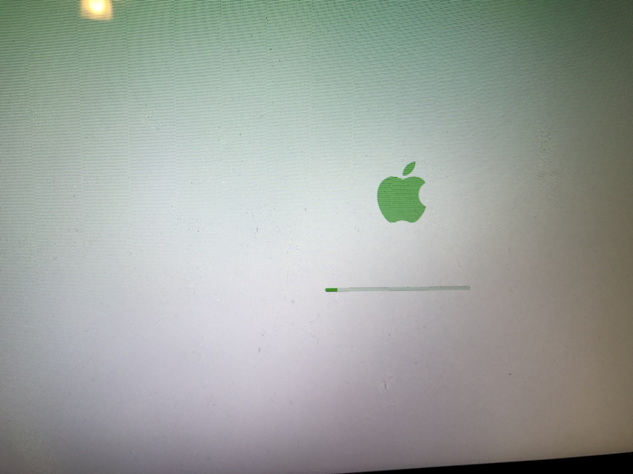 MacBook Pro booting with green Apple logo - Apple Community